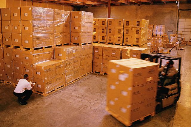 Forklift Moving Boxes in Warehouse